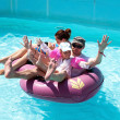 Family floating on an inflatable raft — 图库照片