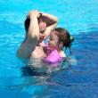 Joyful little girl with dad in the pool — Стоковое фото