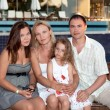 Family holiday in the evening on the bench. — Stock Photo