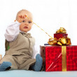 Stock Photo: One year old baby with gifts. Day of birth.