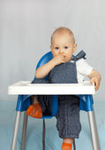 Thoughtful year old kid at the table. — Stock Photo