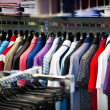 Clothes for men on a hanger in shop - Stockfoto