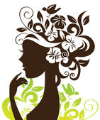 Beautiful woman silhouette with flowers and bird — Stock Vector