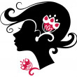 Beautiful woman silhouette with a flowers — Stock Vector