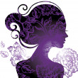 Beautiful woman silhouette with a flowers — Stock Vector #7398073