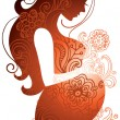 Silhouette of pregnant woman — Stock Vector #7398085