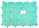 Green puzzle with missing piece — Stockfoto