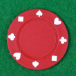 Red poker chip on green background — Stock Photo