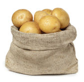 Potatoes in burlap sack on white background — Stock Photo