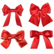 Red gift satin ribbon bows on white background - Stock Photo