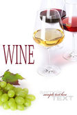 Glasses of white, red and rose wine and grapes — Stock Photo