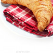 Fresh croissant on plate — Stock Photo