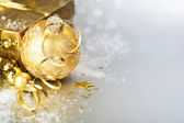 Gold christmas ball and gift — Foto Stock