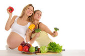 Two gay friends with fruits and vegetables — Stock Photo