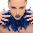 Woman with blue fingernails and blue feathers — Stock Photo