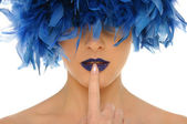 Woman with blue feathers lips and closed eyes — Stockfoto