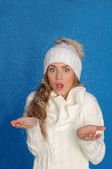 Surprised woman in winter clothes under snow — Stock Photo