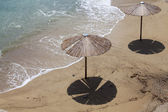 Sandy beach with umbrellas — Stock Photo