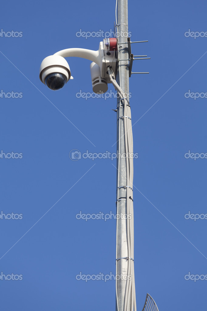 Surveillance camera mounted on the pole to oversee road — Stock Photo #7499298