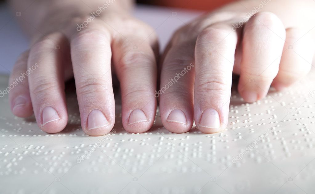 Blind reading text in braille language  Stock Photo #7499440