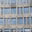 Stock Photo: Facade building detail of glass and cement