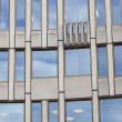 Facade building detail of glass and cement — Stock Photo