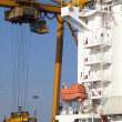 Cranes load containers - Stock Photo