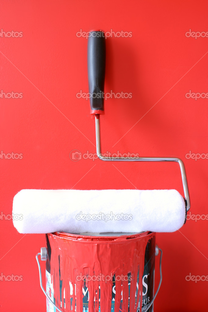 Paint roller on top of  red paint can for home decorating  Stock Photo #6751665
