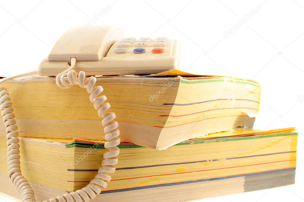 Home telephone on top of phone directories — Stock Photo #6752171