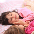 Stock Photo: Little girls waking up