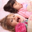 Little girls waking up — Stock Photo