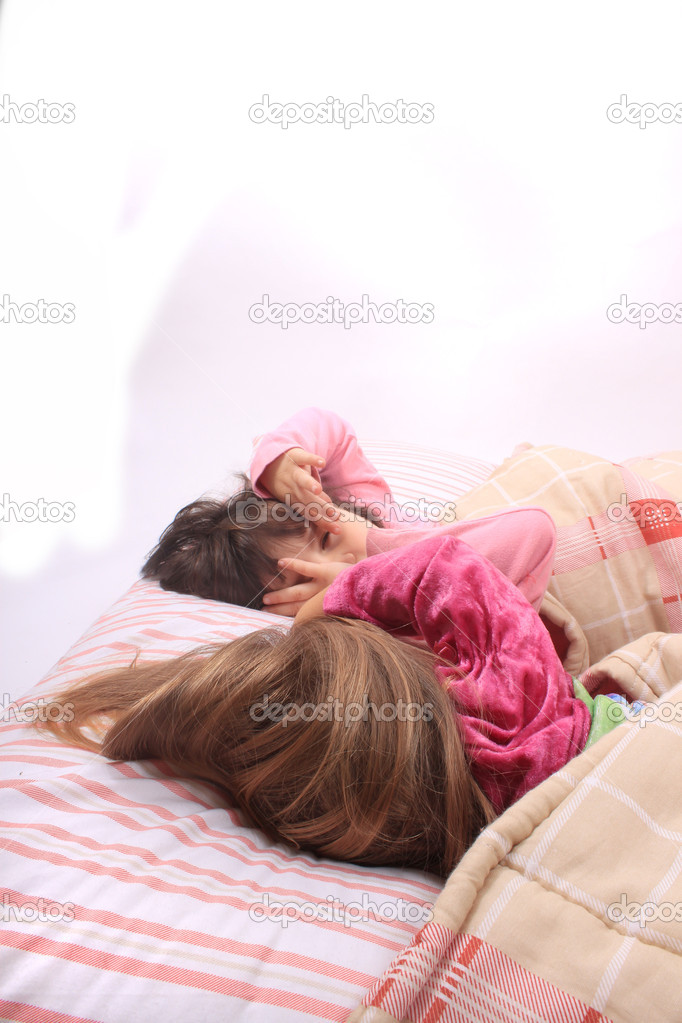 Sleepy little girls just waking up in bed — Stock Photo #6851803