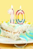 Slice of tenth birthday cake — Stock Photo