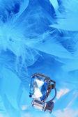 Glamorous blue diamond and feather boa — Stock Photo