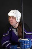 Teen male hockey player — Stockfoto