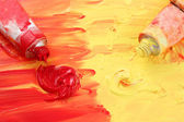 Artist's red and yellow paint — Stock Photo