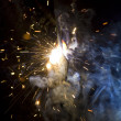 Stock Photo: Metal welding sparks