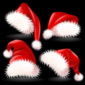 Four Santa's Hats — Stock Vector