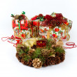 Stock Photo: Christmas fir-cone wreath with candle and presents
