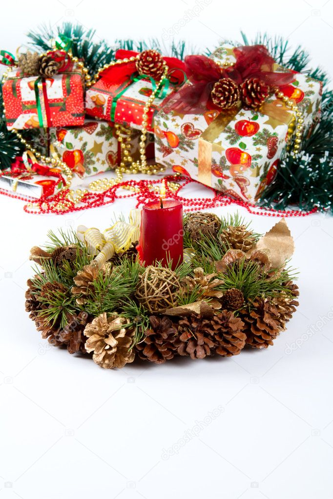 Christmas and New Year fir-cone wreath with candle and presents — Stock Photo #7823055
