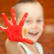 Smiling boy with his hands in the paint — Stock Photo #6907849