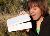 Smiling young woman opened white box — Stok fotoğraf