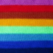 Closeup of the texture of a knitted rainbow scarf — Stock Photo