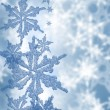 Blue abstract snowflakes background — Stock Photo #7107593