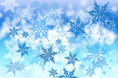 Abstract blurred snowflakes background. — Stock Photo