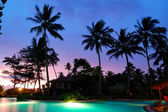 Sunset and illuminated swimming pool, Bentota, Sri Lanka — Stockfoto