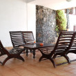 Table, chairs and glass of juice at popular hotel, Bentota, Sri - Stock Photo