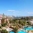 Panorama of luxury hotel and Playa de las Americas at background — Stock Photo