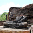 The remains of Lord Buddha statues and stupa in Polonnaruwa Vata - Stock Photo
