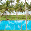 The swimming pool and beach of luxury hotel, Bentota, Sri Lanka - Stock Photo